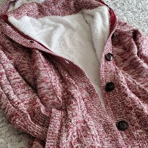 SWEATER WITH ZIPPER AND BUTTONS.